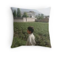 Pakistan- An Afghan boy  view the house of former al-Qaida leader Osama bin Laden Throw Pillow