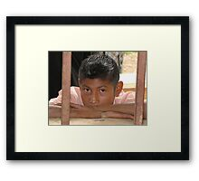 Boy Looking Through the Window Framed Print