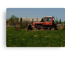 Spring in old farmstead (rural tractor) Canvas Print