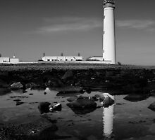 Lighthouse with reflection. by KWTImages