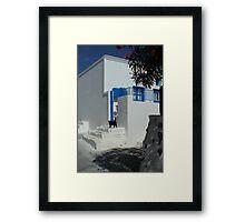 black cat at front of a white house in santorini Framed Print