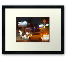 Blur and defocused silhouette of the car and traffic lights Framed Print