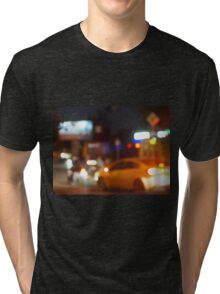 Blur and defocused silhouette of the car and traffic lights Tri-blend T-Shirt