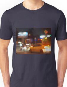 Blur and defocused silhouette of the car and traffic lights Unisex T-Shirt