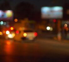 Abstract night scene with blurred headlights by vladromensky