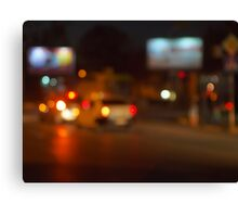 Abstract night scene with blurred headlights Canvas Print