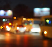 Defocused lights from the headlights of cars and traffic lights by vladromensky