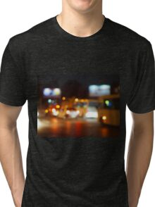 Defocused lights from the headlights of cars and traffic lights Tri-blend T-Shirt