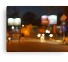 Abstract urban night scene with blurred headlights on the road Canvas Print