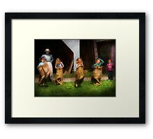 Children - The sack race  Framed Print