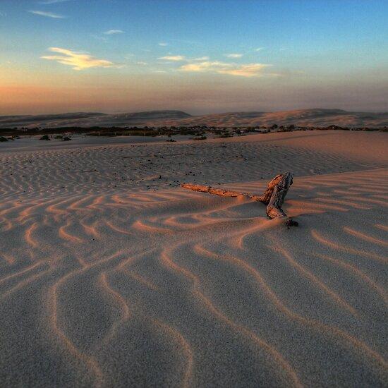 beach sand. Sunset at Birubi Beach Sand