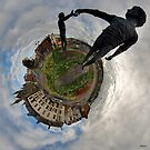 June's Photograph - Hands Across the Divide sculpture Panorama - Buy it as a Framed Print
