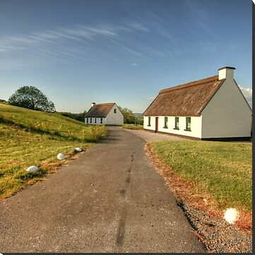 Thatched cottages near Corofin village in county Clare overlooking Inchiquin lake