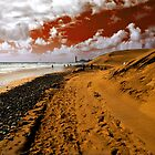 Red sky on the beach by Rob Hawkins