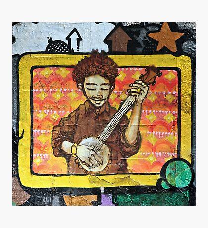 Graffiti art, Glasgow; man strumming mandolin Photographic Print