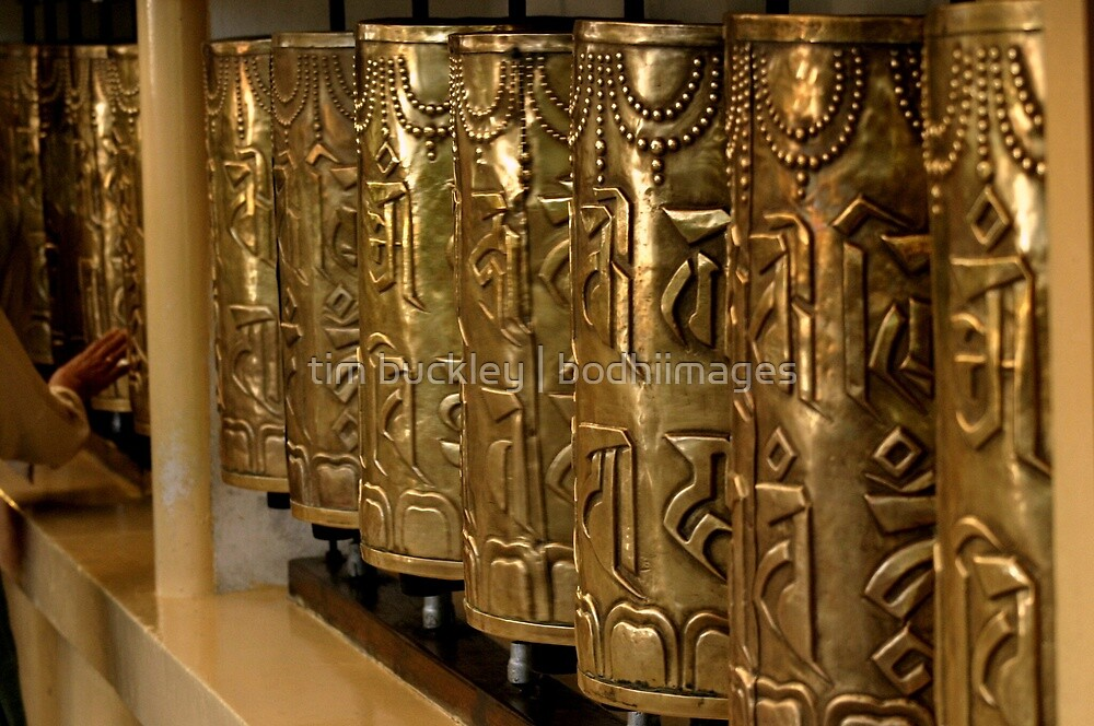 polished prayer wheels. india by tim buckley | bodhiimages