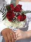 Red roses and wedding rings by endomental Artistry