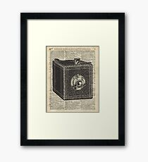 Antique Cube Camera Over Old Encyclopedia Page Framed Print