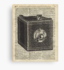 Antique Cube Camera Over Old Encyclopedia Page Canvas Print