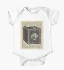 Antique Cube Camera Over Old Encyclopedia Page Kids Clothes