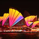 Vivid Opera House .. with cruise boat by Michael Matthews