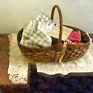 Basket of Cloth and Measuring Tape by Susan Savad