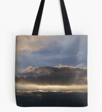 Sunset behind clouds with rays Tote Bag