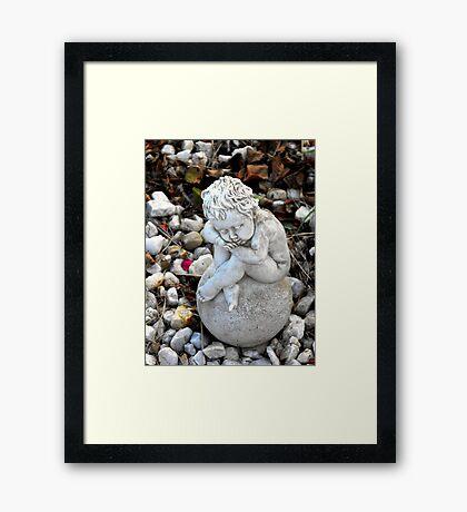 Sitting on an Orb Framed Print
