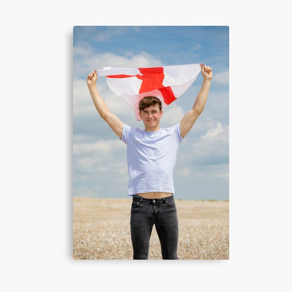 A young man with the Flag of England, the cross of St George Canvas Print