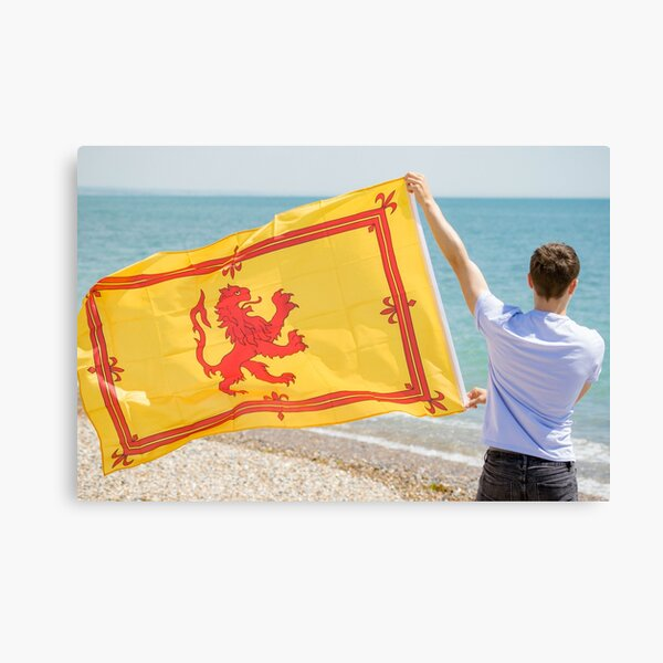 A young man with a Lion Rampant of Scotland flag Canvas Print