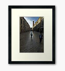 Child wandering along Stradun, Dubrovnik, Croatia Framed Print