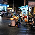 Street vendor selling bread at night. Vung Tau, Vietnam by Sheldon Levis