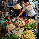 Woman shopping at fresh vegetable market. Vung Tau, Vietnam by Sheldon Levis