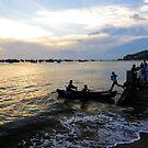 Man leaps across water to boat. Hang Dua Bay, Vung Tau, Vietnam by Sheldon Levis