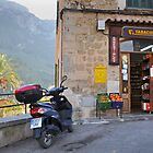 Village shop and scooter, Deia, Mallorca, Spain by Nick  Gill