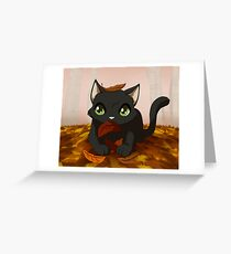 Kitty playing in autumn leaves Greeting Card