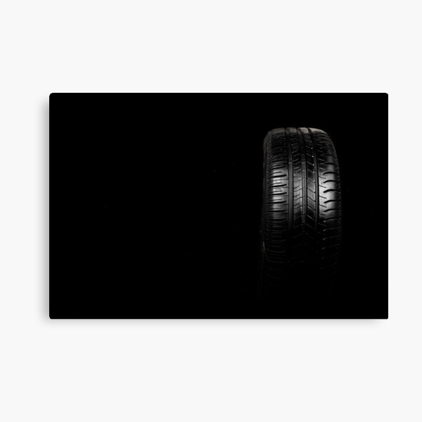 Car tyre isolated on a black background Canvas Print