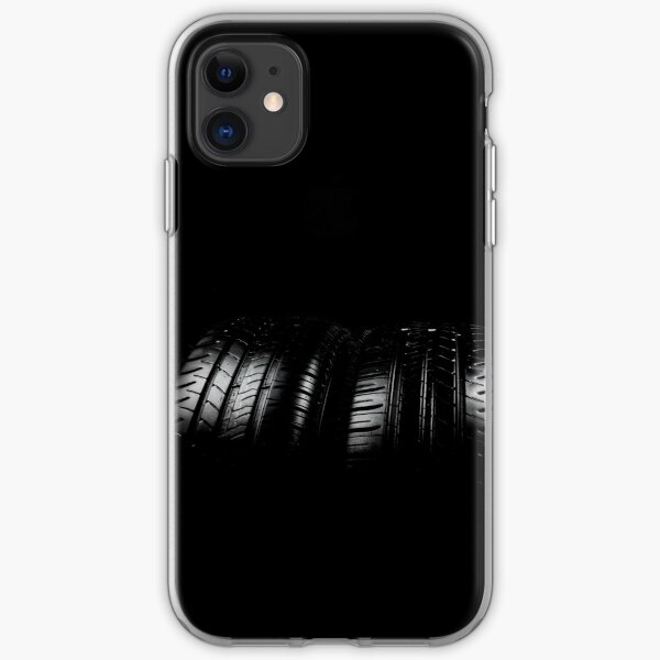 Close up view of car tyres isolated on a black background iPhone Soft Case