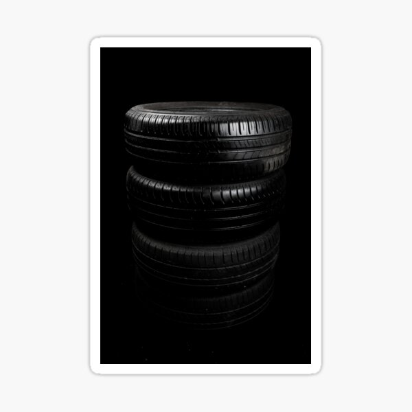 Close up view of car tyres isolated on a black background Sticker