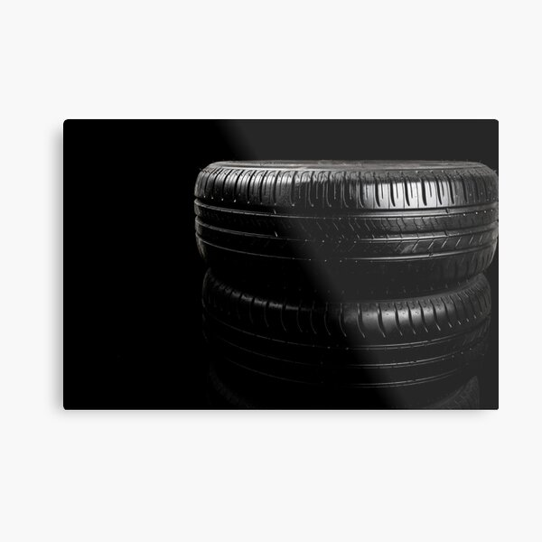 Close up view of car tyres isolated on a black background Metal Print