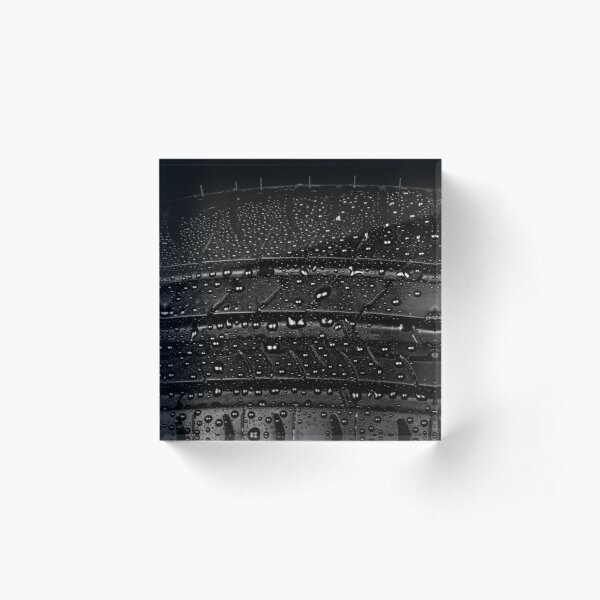 Car tyre isolated on a black background Acrylic Block