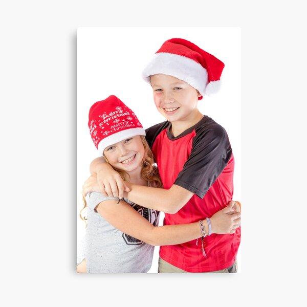 Siblings embracing for christmas Canvas Print