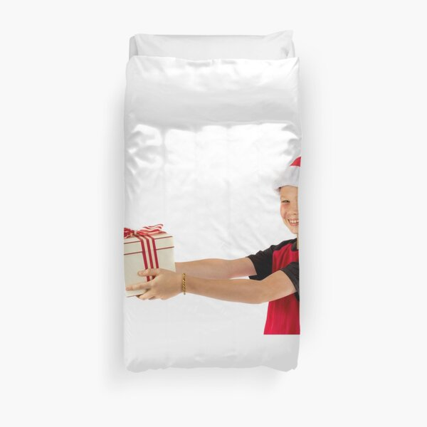 Pre-teen boy with a christmas gift Duvet Cover