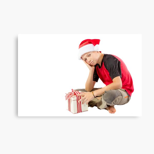 Pre-teen boy with a christmas gift Canvas Print