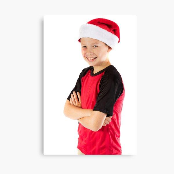 Pre-teen boy wearing a christmas hat Canvas Print
