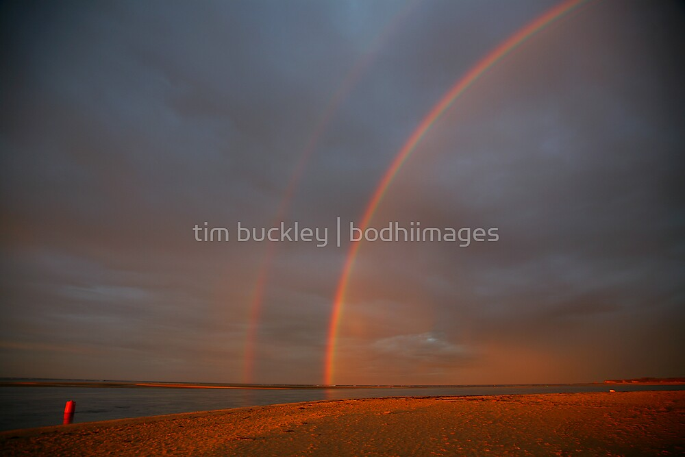 rainbow sunrise. inverloch, victoria by tim buckley | bodhiimages
