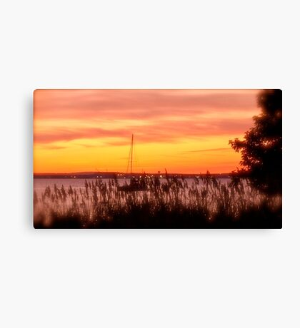 Sailboat Safely Moored At Sunset  Canvas Print