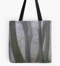 Tree trunks in the mist Tote Bag