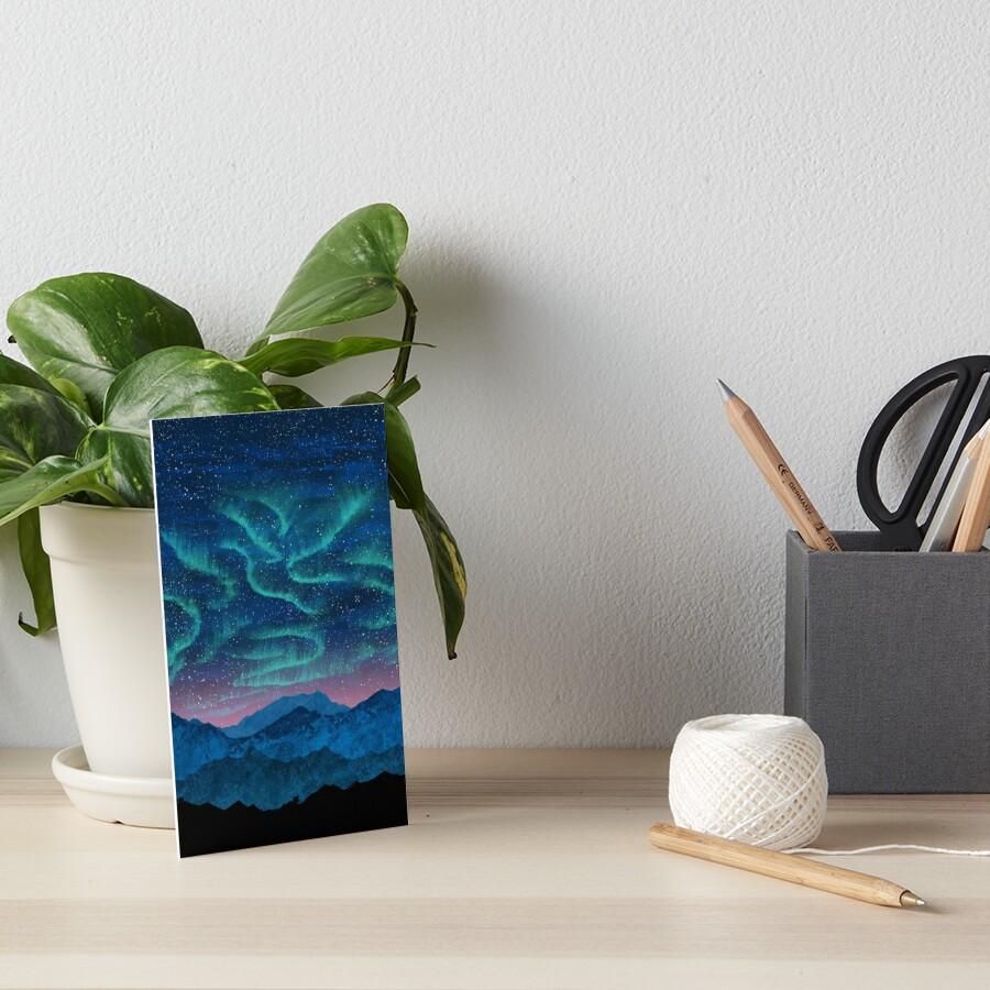 Aurora borealis over mountains Art Board Print