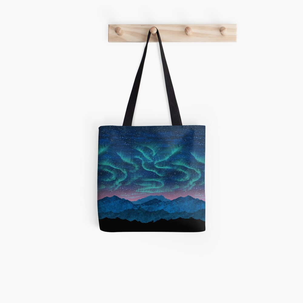 Aurora borealis over mountains Tote Bag